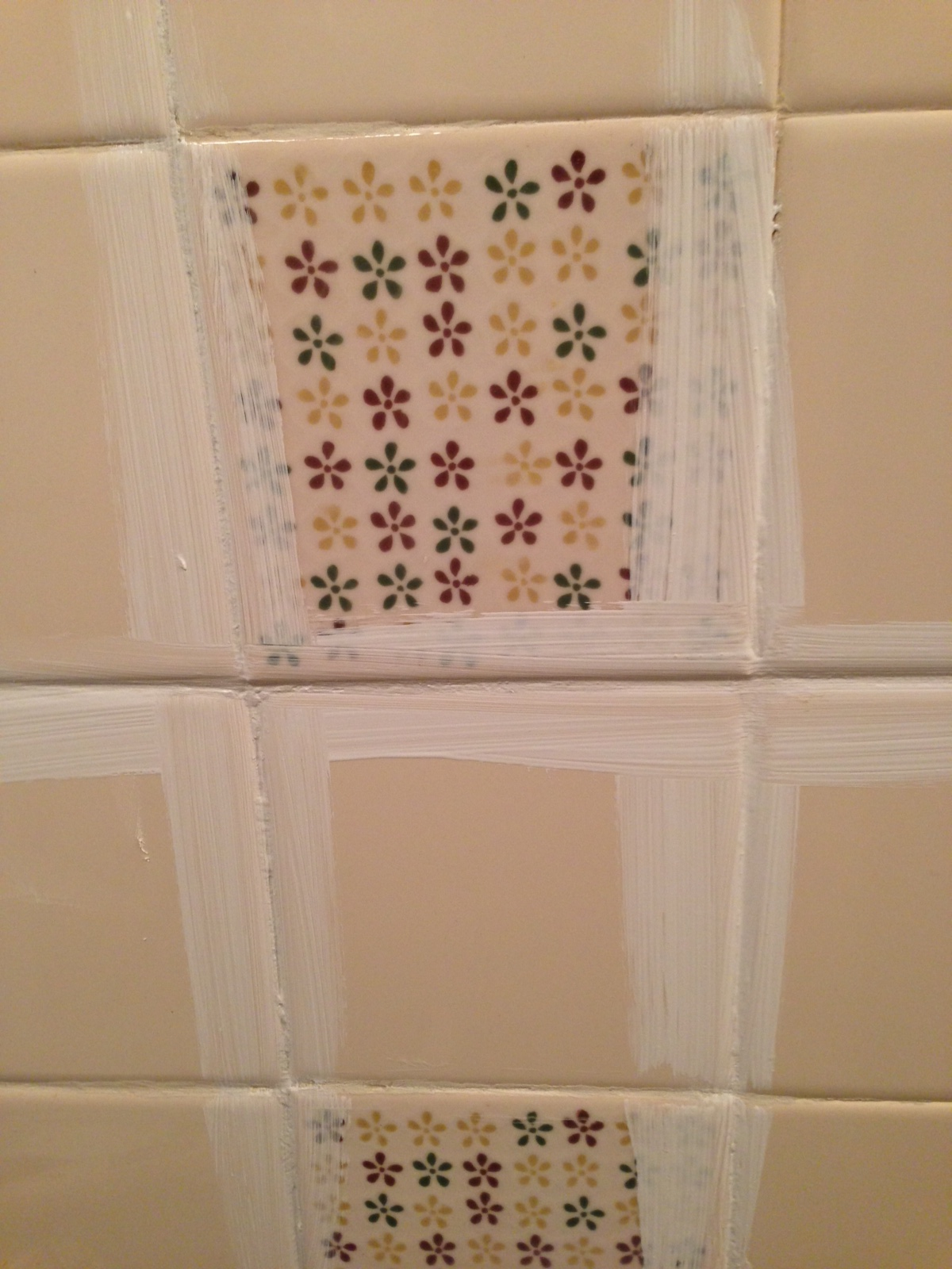 Remodelaholic a 170 bathroom makeover with painted tile for Can you paint over vinyl flooring
